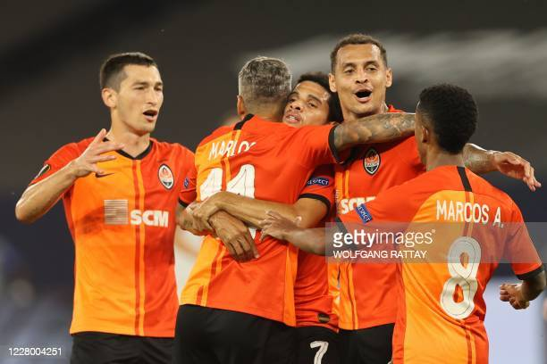 Shakhtar Donetsk's Brazilian midfielder Taison is congratuled by teammates after scoring a goal during the UEFA Europa League quarter-final football...