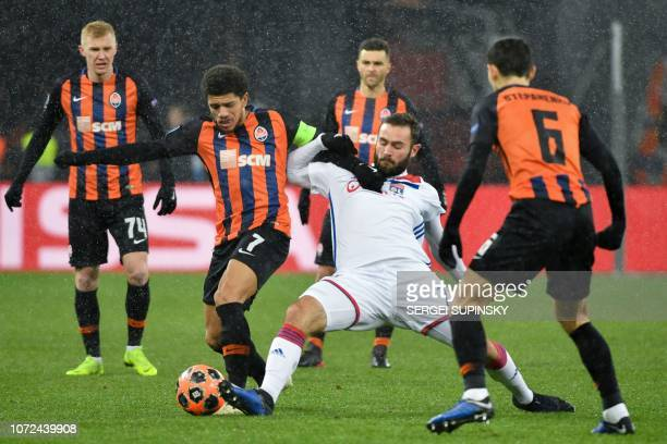 Shakhtar Donetsk's Brazilian midfielder Taison vies for a ball with Lyon's French midfielder Lucas Tousart during the UEFA Champions League Groupe F...