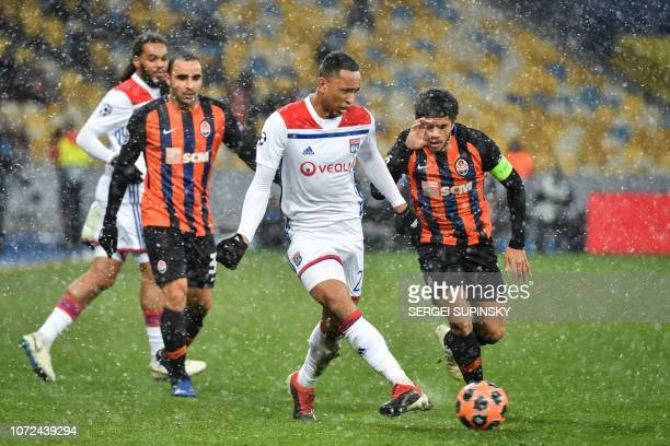 Shakhtar Donetsk's Brazilian midfielder Taison vies for the ball with Lyon's Dutch defender Kenny Tete during the UEFA Champions League Groupe F...