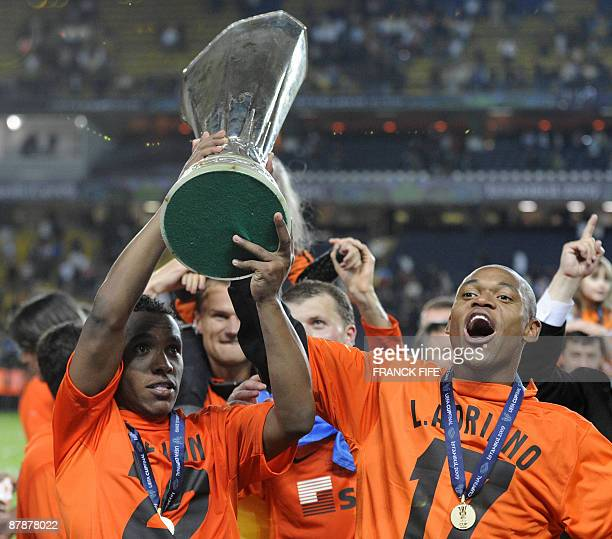 Shakhtar Donetsk's Brazilian midfielder Willian and Shakhtar Donetsk's Brazilian forward Luiz Adriano celebrate with the UEFA Cup trophy after their...