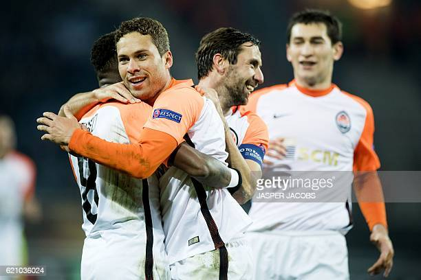 Shakhtar Donetsk's Brazilian midfielders Fred and Marlos celebrate after scoring a goal during the UEFA Europa League football match between KAA Gent...