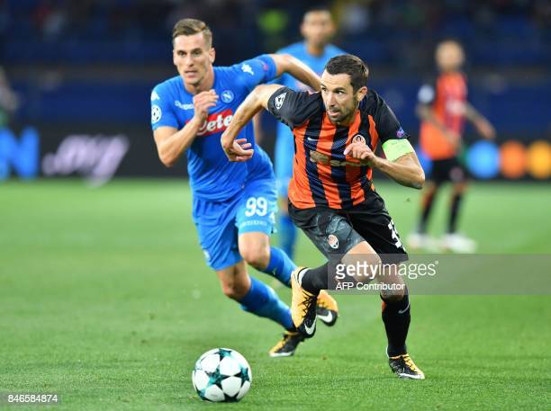 Shakhtar Donetsk's Croatian defender Darijo Srna and SSC Napoli's Polish forward Arkadiusz Milik vie for the ball during the UEFA Champions League...