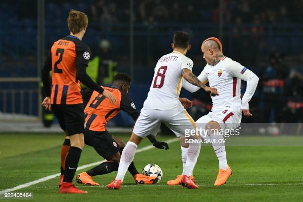 Shakhtar Donetsk's defender Bohdan Butko and Shakhtar Donetsk's midfielder Fred vie for the ball with Roma's Argentinian midfielder Diego Perotti and...