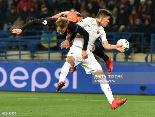 Shakhtar Donetsk's defender Bohdan Butko fights for the ball with Roma's Argentinian midfielder Diego Perotti during the UEFA Champions League round...