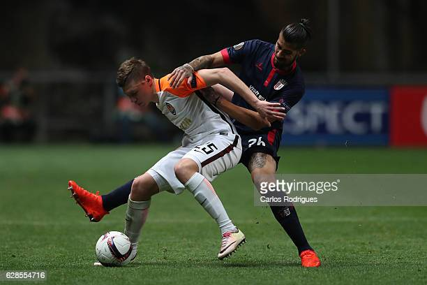 Shakhtar Donetsk's defender Mykola Matviyenko vies with Braga's forward Oscar Benitez from Portugal during the UEFA Europe League match between SC...
