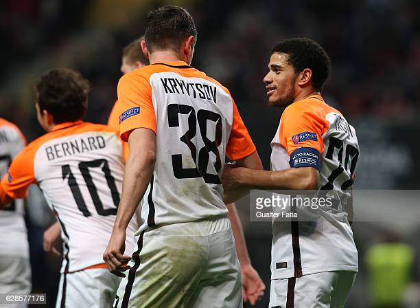 Shakhtar Donetsk's defender Serhiy Kryvtsov celebrates with team mate FC Shakhtar Donetsk's midfielder Taison after scoring a goal during the UEFA...