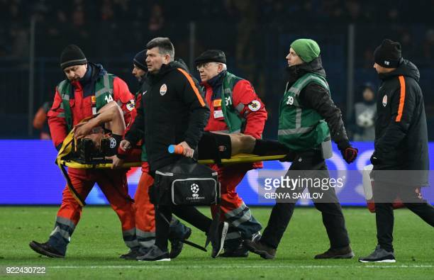 Shakhtar Donetsk's defender Serhiy Kryvtsov reacts as he is taken off the field on a stretcher after injury during the UEFA Champions League round of...