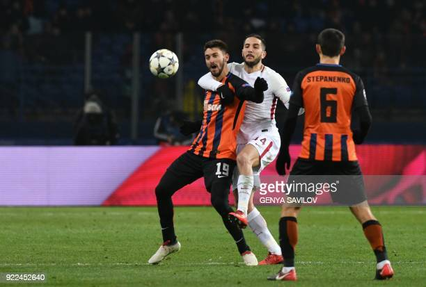 Shakhtar Donetsk's forward Facundo Ferreyra and Shakhtar Donetsk's midfielder Taras Stepanenko vie for vies for the ball with Roma's Greek defender...