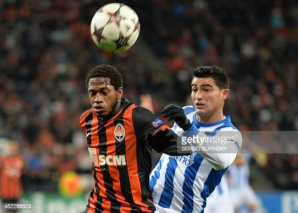 FC Shakhtar Donetsk's Fred and Real Sociedads Chori Castro fight for the ball during their UEFA Champions League Group A football match in Donetsk on...
