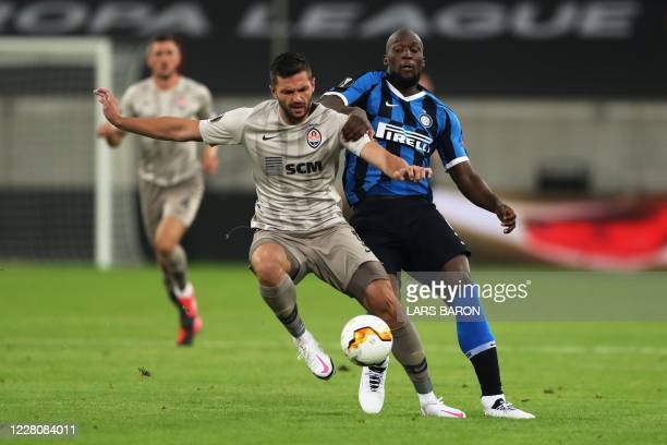 Shakhtar Donetsk's Georgian defender David Khocholava and Inter Milan's Belgian forward Romelu Lukaku vie for the ball during the UEFA Europa League...