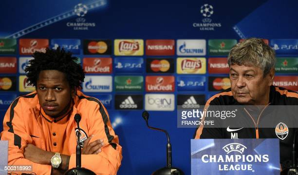 Shakhtar Donetsk's head coach Mircea Lucescu and Shakhtar Donetsk's Brazilian midfielder Fred give a press conference at the Parc des Princes stadium...