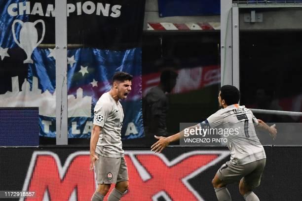Shakhtar Donetsk's Israeli forward Manor Solomon celebrates with Shakhtar Donetsk's Brazilian midfielder Taison after scoring during the UEFA...