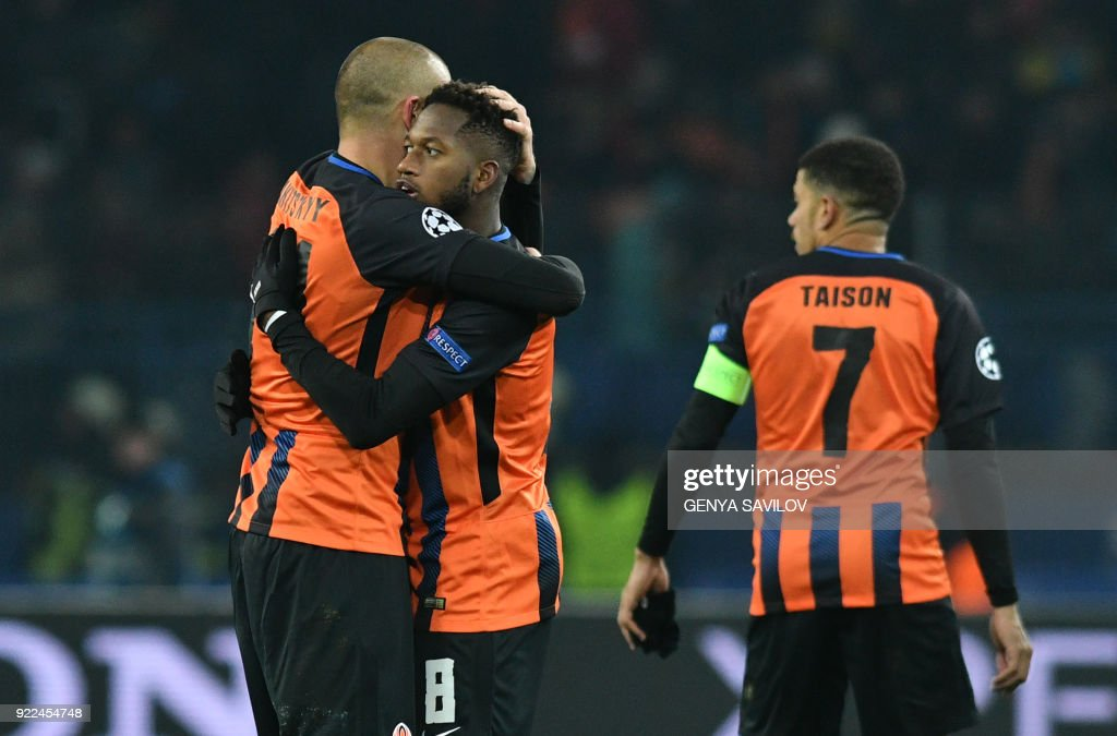 Shakhtar Donetsk's midfielder Fred (C) is embraced by teammate Shakhtar Donetsk's forward Yaroslav Rakitskiy at the end of the UEFA Champions League round of 16 first leg football match between Shaktar Donetsk and AS Rome at The OSK Metalist Stadion in Kharkiv on February 21, 2018. /