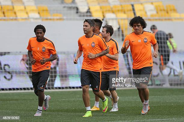 Shakhtar Donetsk's midfielders Fred Marlos Bernard and midfielder Azavedo take part in their team's training session at Lviv Arena on August 04 2015...