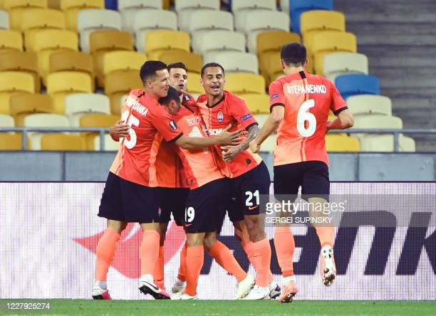 Shakhtar Donetsk's players celebrate a goal during the UEFA Europa League round of 16 second leg football match between FC Shakhtar Donetsk and VfL...