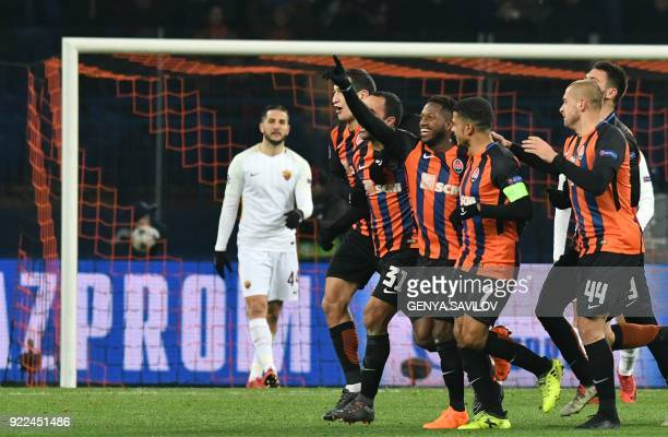 Shakhtar Donetsk's players celebrate the goal scored by midfielder Fred during the UEFA Champions League round of 16 first leg football match between...