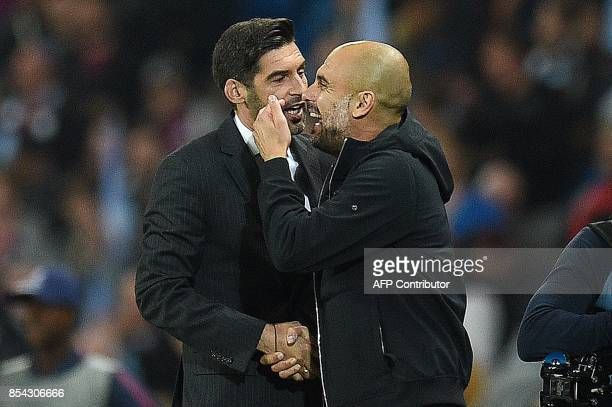 Shakhtar Donetsk's Portuguese manager Paulo Fonseca and Manchester City's Spanish manager Pep Guardiola embrace following the Group F football match...