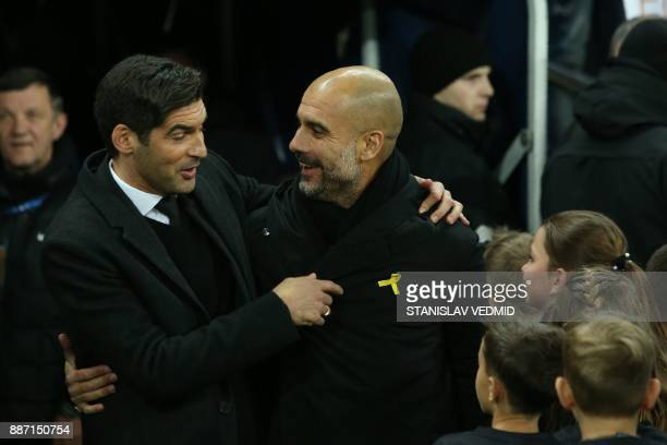 Shakhtar Donetsk's Portuguese manager Paulo Fonseca greets his opponent Manchester City's Spanish manager Pep Guardiola prior to the UEFA Champions...