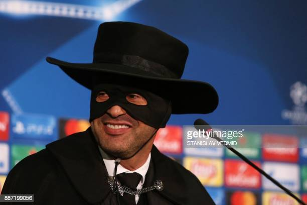 Shakhtar Donetsk's Portuguese manager Paulo Fonseca wearing a Zorro mask and hat delivers a press conference after Shakhtar Donetsk won their UEFA...