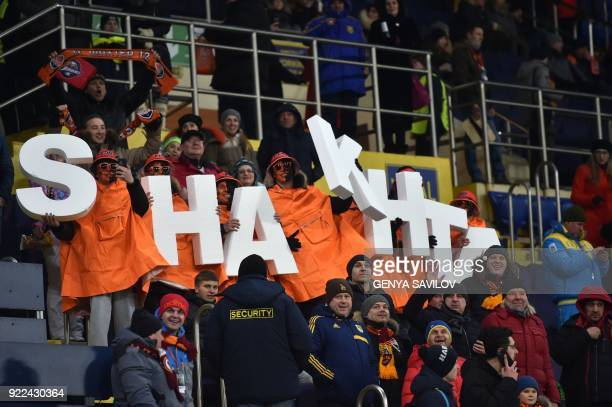 Shakhtar Donetsk's supporters cheer for their team during the UEFA Champions League round of 16 first leg football match between Shaktar Donetsk and...