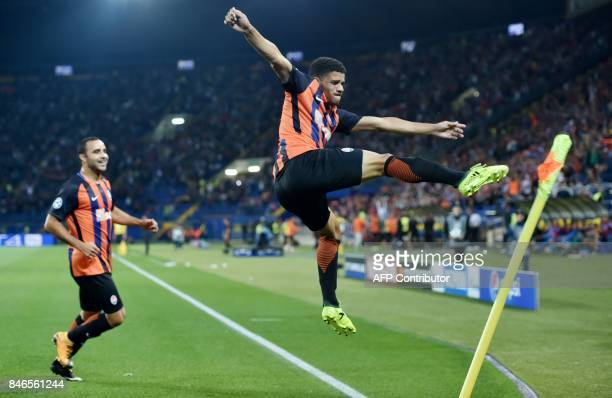 FC Shakhtar Donetsk's Taison celebrates with a teammate after scoring during the UEFA Champions League Group F football match between FC Shakhtar...
