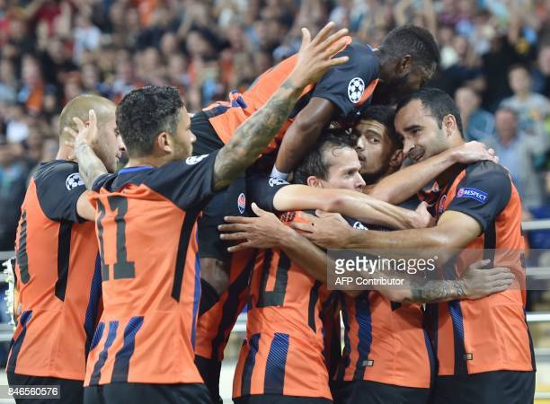 FC Shakhtar Donetsk's Taison celebrates with teammates after scoring during the UEFA Champions League Group F football match between FC Shakhtar...