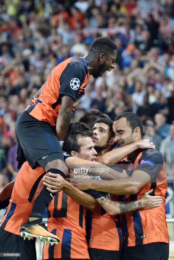 FC Shakhtar Donetsk's Taison (C) celebrates with teammates after scoring during the UEFA Champions League Group F football match between FC Shakhtar Donetsk and SSC Napoli at The Metalist Stadium in Kharkiv on September 13, 2017. /