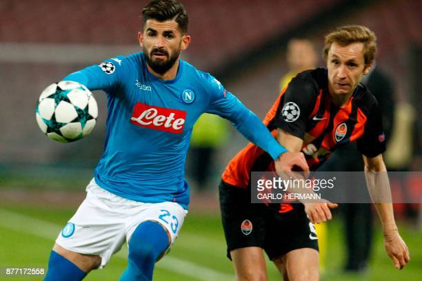 Shakhtar Donetsk's Ukrainian defender Bohdan Butko vies with Napoli's defender from Albania Elseid Hysaj during the UEFA Champions League Group F...
