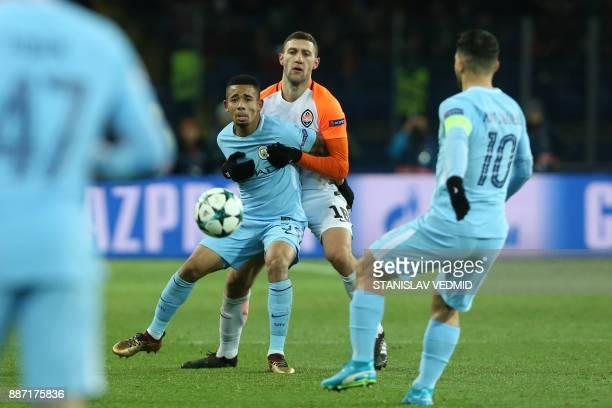 Shakhtar Donetsk's Ukrainian defender Ivan Ordets blocks Manchester City's Brazilian striker Gabriel Jesus during the UEFA Champions League group F...