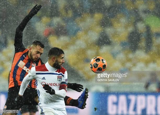 Shakhtar Donetsk's Ukrainian defender Mykola Matviyenko and Lyon's French forward Nabil Fekir vies for the ball during the UEFA Champions League...