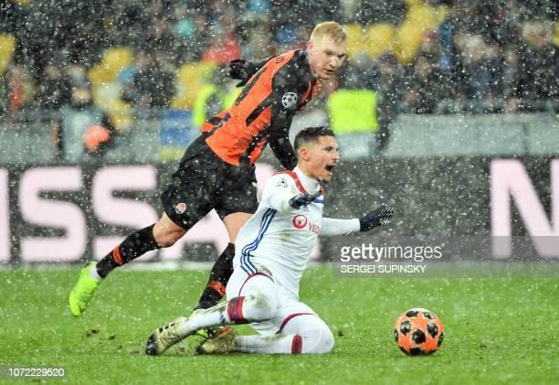 Shakhtar Donetsk's Ukrainian defender Serhiy Kryvtsov and Lyon's French midfielder Houssem Aouar vie for the ball during the UEFA Champions League...
