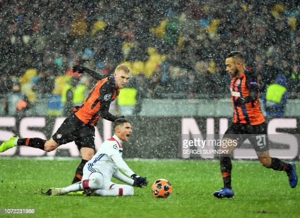 Shakhtar Donetsk's Ukrainian defender Serhiy Kryvtsov and Lyon's French midfielder Houssem Aouar vie for the ball during during the UEFA Champions...