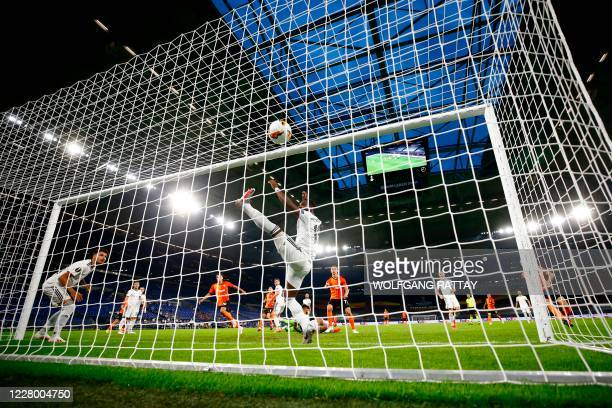 Shakhtar Donetsk's Ukrainian forward Junior Moraes scores a goal during the UEFA Europa League quarterfinal football match Shakhtar Donetsk v FC...