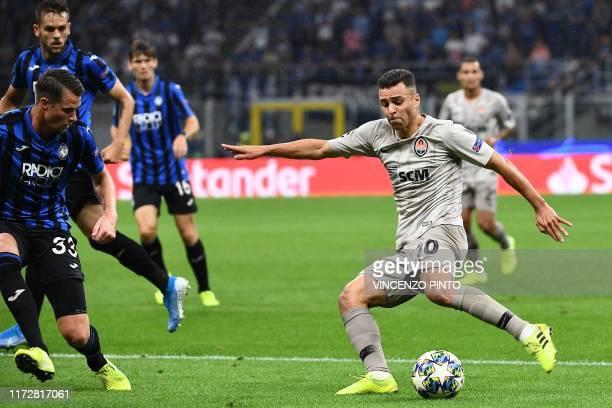 Shakhtar Donetsk's Ukrainian forward Junior Moraes shoots on goal during the UEFA Champions League Group C stage football match Atalanta Bergamo vs...