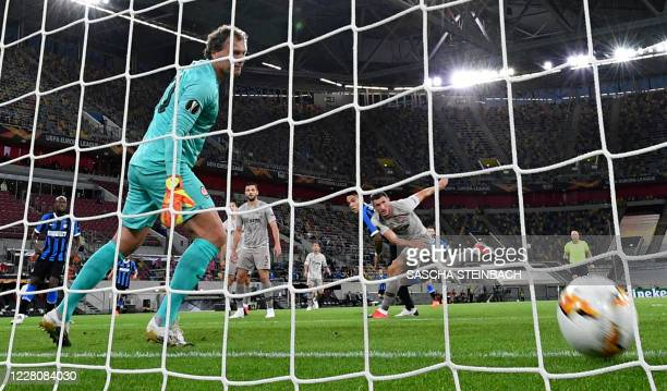 Shakhtar Donetsk's Ukrainian goalkeeper Andrey Pyatov fails to save the opening goal by Inter Milan's Argentinian forward Lautaro Martinez during the...