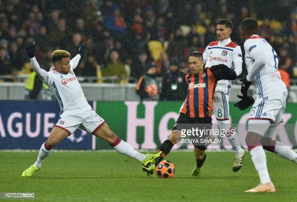 Shakhtar Donetsk's Ukrainian midfielder Marlos and Lyon's Brazilian defender Marcal vie for the ball during the UEFA Champions League Groupe F...