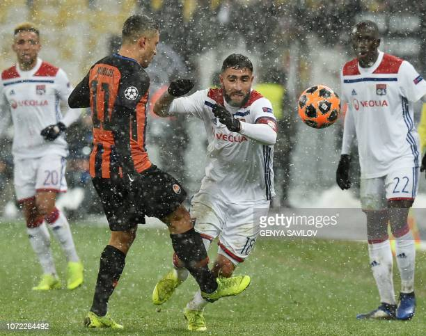 Shakhtar Donetsk's Ukrainian midfielder Marlos and Lyon's French forward Nabil Fekir vie for the ball during the UEFA Champions League Groupe F...