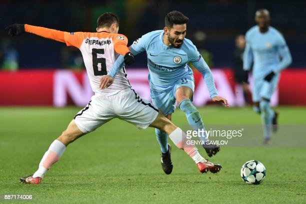 Shakhtar Donetsk's Ukrainian midfielder Taras Stepanenko vies with Shakhtar Donetsk's Brazilian midfielder Fred during the UEFA Champions League...