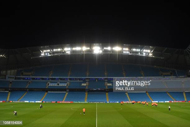 Shakhtar players take part in a training session at the Etihad Stadium in Manchester north west England on November 6 on the eve of the UEFA...