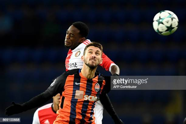 Shakhtar's Argentinian forward Facundo Ferreyra jumps for the ball with Feyenoord's Dutch defender Ridgeciano Haps during the UEFA Champions League...
