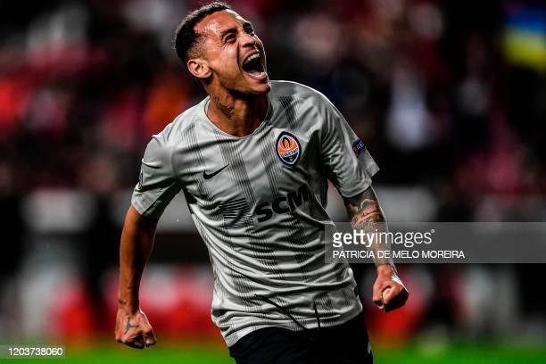 Shakhtar's Brazilian midfielder Alan Patrick celebrates after scoring during the UEFA Europa League round of 32 second leg football match between SL...