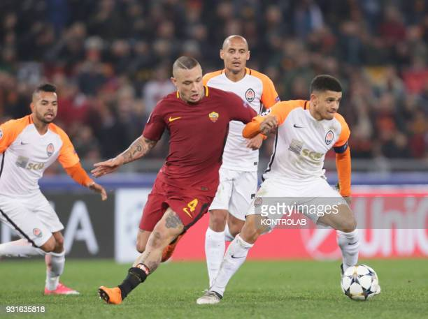 Shakhtar's Brazilian midfielder Taison fights for the ball with Roma's Belgian midfielder Radja Nainggolan during the UEFA Champions League Round of...