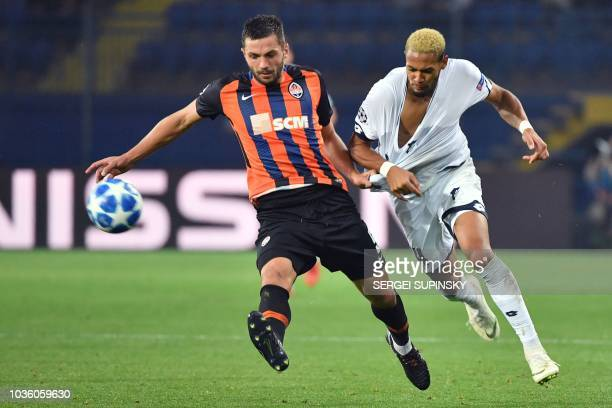 Shakhtar's David Khocholava vies with Hoffenheim's Joelinton Cassio during the UEFA Champions League Group F football match between FC Shakhtar...