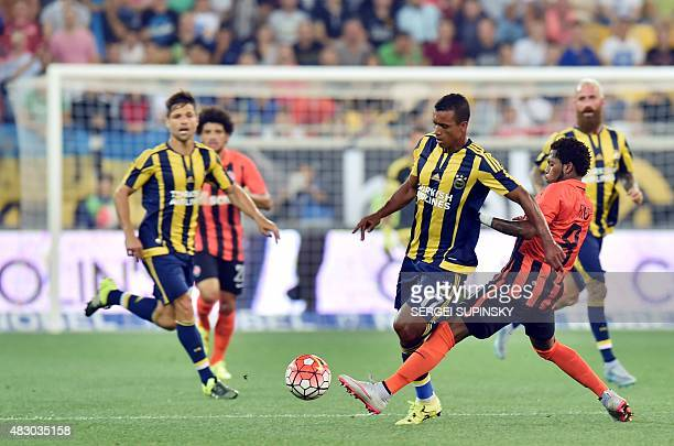 Shakhtar's Fred and Fenerbahce's Nani vie for the ball during the UEFA Champions League third qualifying round football match between FC Shakhtar...