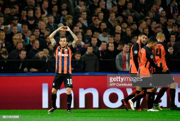 Shakhtar's midfielder Bernard celebrates after scoring a goal during the UEFA European Champions League Group F football match between Feyenoord and...