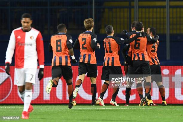 FC Shakhtar's players celebrate after scoring a goal during the UEFA Champions League Group F football match between FC Shakhtar Donetsk and...
