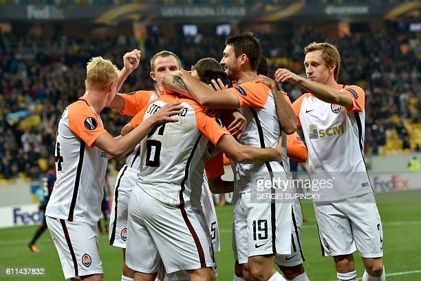FC Shakhtar's players celebrate scoring a goal during the UEFA Europa League football match FC Shakhtar Donetsk vs SC Braga at the Arena Lviv stadium...