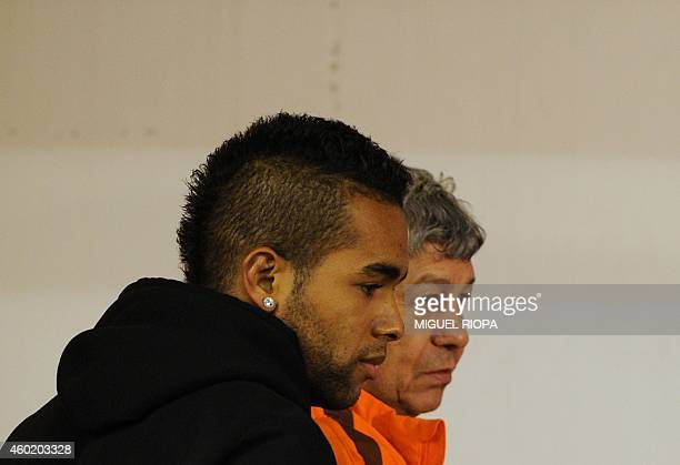 Shakhtar's Romanian coach Mircea Lucescu and Brazilian midfielder Alex Teixeira arrive for a press conference at the Dragao Stadium in Porto on...