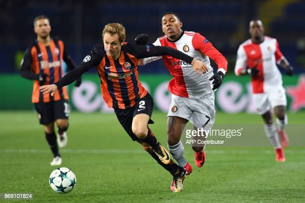 Shakhtar's Ukrainian defender Bohdan Butko vies for the ball with Feyenoord's Dutch striker JeanPaul Boetius during the UEFA Champions League Group F...