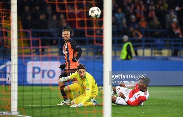 Shakhtar's Ukrainian midfielder Marlos eyes the ball as he scores a goal past Feyenoord's Australian goalkeeper Brad jones during the UEFA Champions...